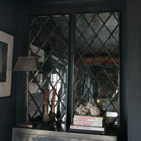 A Pair Of Antique Harlequin Cast Iron Window Frame Mirrors